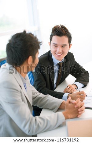 Business partners being enthusiastic about cooperation