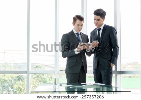 business partners discussing documents and ideas in office