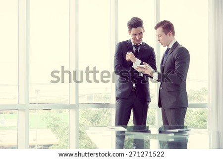 business partners discussing documents and ideas in office - stock photo