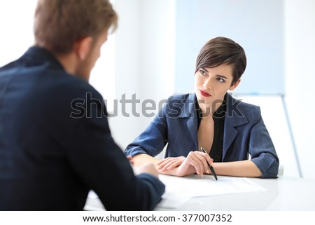 business partners discussing documents and ideas in the office - stock photo