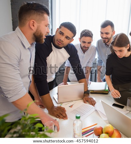 Business partners discussing new business projects and strategies for their companies, enterprises, firms. Creative office workers working round table in office. - stock photo