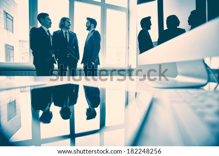 Business partners discussing new strategy in the meeting room  - stock photo