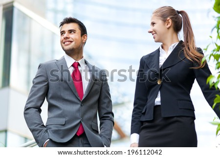 Business partners discussing while on the stairs  - stock photo