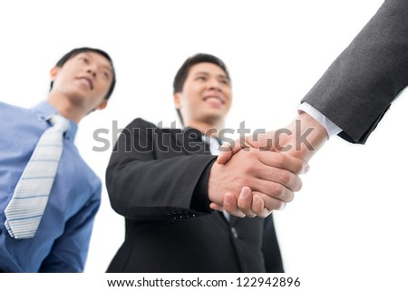 Business partners exchanging firm handshakes - stock photo