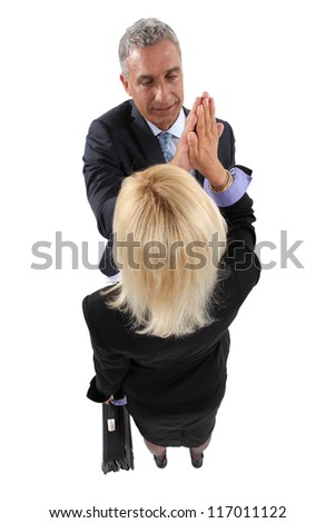Business partners giving each other a high-five - stock photo