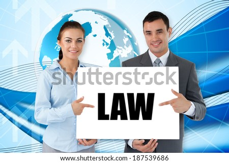 Business partners holding card saying law against global business graphic in blue