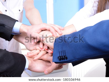 Business partners joining their hands