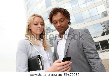 Business partners meeting outside - stock photo