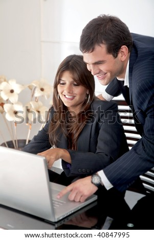 business partners on a laptop computer in an office