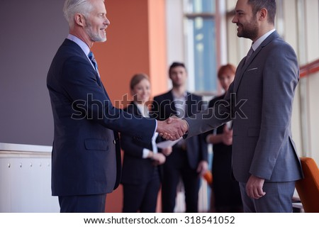 business partners, partnership concept with two businessman handshake - stock photo