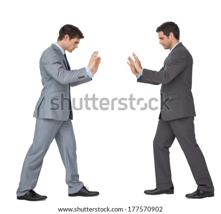 Business partners pushing copy space looking down on white background