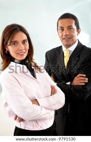 Business partners smiling in an office - man and woman - stock photo