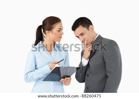 Business partners talking about data against a white background