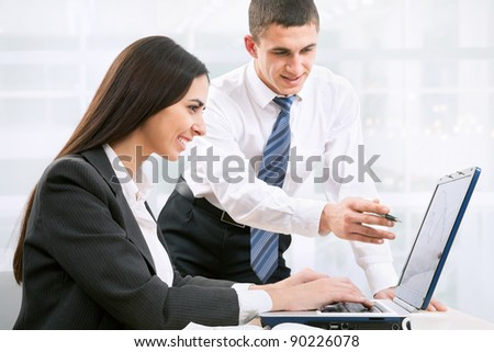 Business partners working at a computer in the office - stock photo