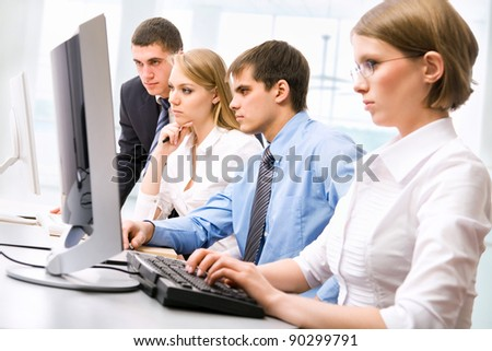 Business partners working at a computers in the office