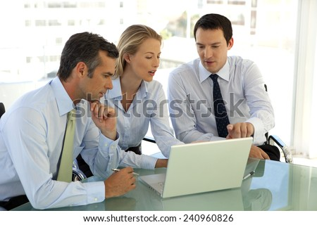 Business partners working together - stock photo
