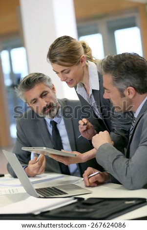 Business partners working together in office - stock photo