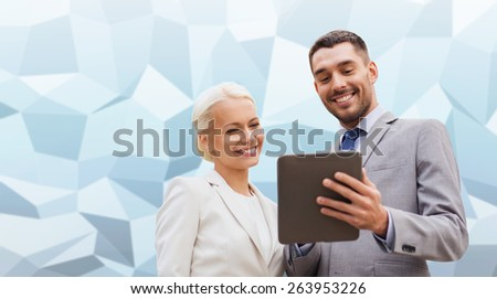 business, partnership, technology and people concept - smiling businessman and businesswoman with tablet pc computer over gray blue graphic low poly background - stock photo