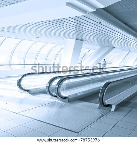 business passage with escalators inside office center - stock photo