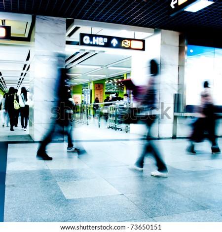 Business passenger walk at subway station at intentional motion blurred - stock photo
