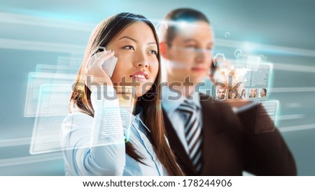 Business people against hightech background - stock photo