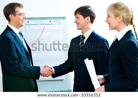 Business people agreed to terms of a treaty by shaking hands