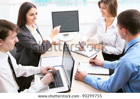 Business people analyzing and discussing during a working meeting in a modern office - stock photo