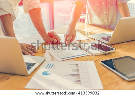 Business people analyzing investment charts. Accounting , with soft focus, vintage tone - stock photo