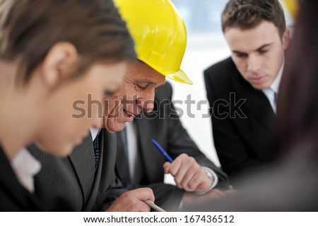 Business people and architects having project meeting at office - stock photo