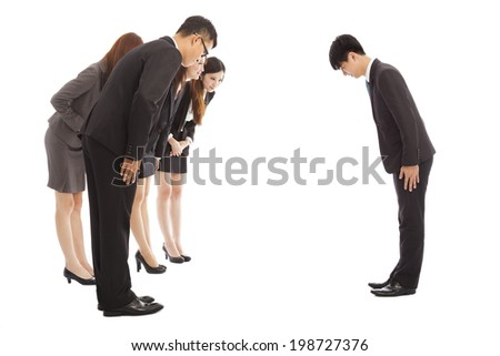 business people and boss with bow and scrape - stock photo