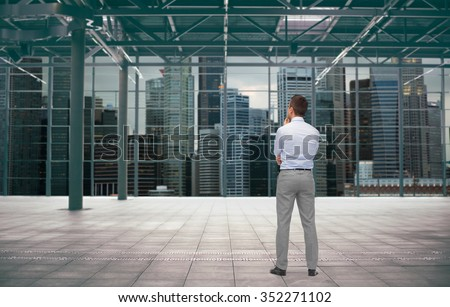 business, people and development concept - businessman thinking over empty urban city construction background from back - stock photo