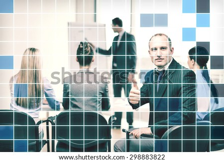 business, people and gesture concept - confident businessman with team in office showing thumbs up over blue squared grid background - stock photo