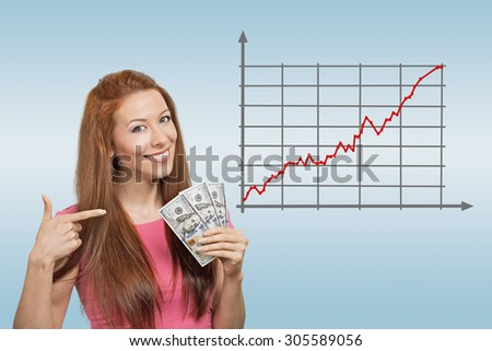 Business, people and money concept. Happy smiling businesswoman with dollar cash money on blue background and forex graph going up