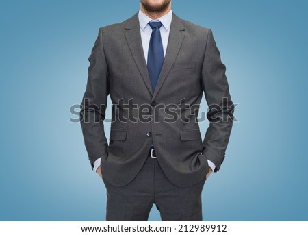 business, people and office concept - close up of businessman over blue background - stock photo