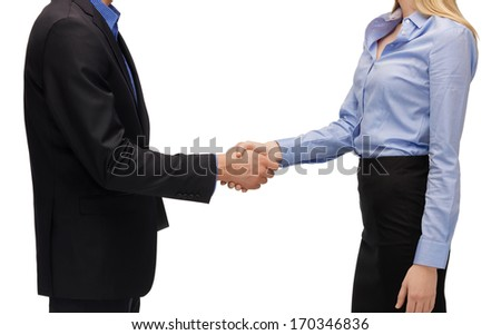 business people and office concept - man and woman shaking their hands - stock photo