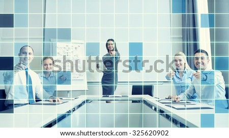 business, people and teamwork concept - group of smiling businesspeople meeting and pointing finger at you in office over blue squared grid background - stock photo