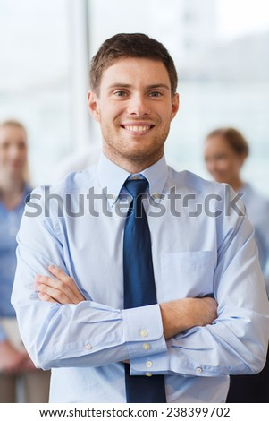 business, people and teamwork concept - smiling businessman with group of businesspeople in office - stock photo
