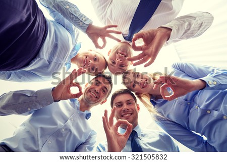 business, people and teamwork concept - smiling group of businesspeople standing in circle - stock photo