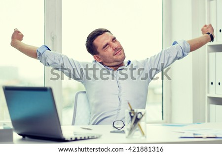business, people and technology concept - bored businessman with laptop computer and papers at office - stock photo