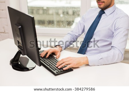 business, people and technology concept - close up of businessman hands typing on computer keyboard at office