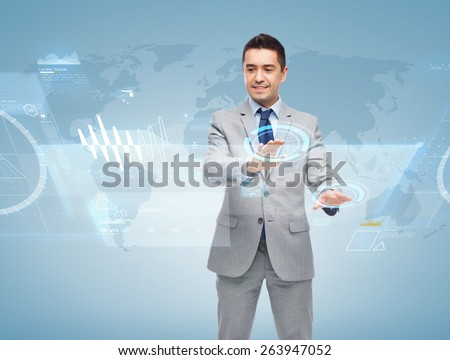 business, people and technology concept - happy smiling businessman in suit working with virtual screens over blue background - stock photo