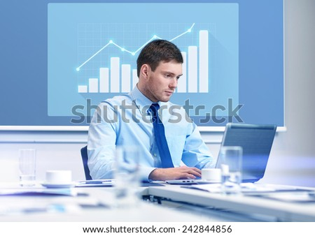 business, people and work concept - businessman with laptop computer and growth chart on virtual screen in office - stock photo