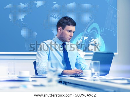 business, people and work concept - businessman with laptop computer and virtual globe hologram in office