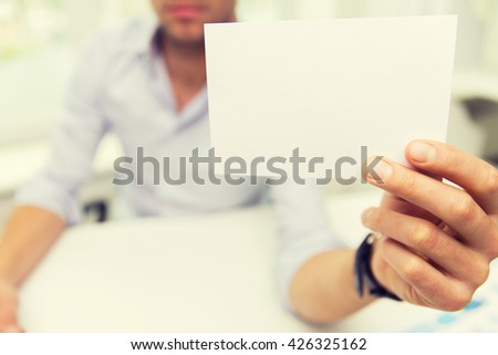 business, people, announcement and advertisement concept - close up of businessman showing blank paper card at office - stock photo