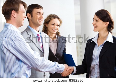 Business people are shaking hands confirming a sale - stock photo