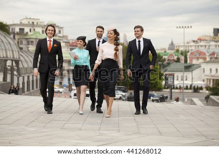 Business people are walking down the street on a background of business centers