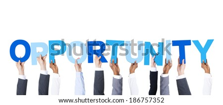 Business People Arms Raised and Holding the Word Opportunity - stock photo