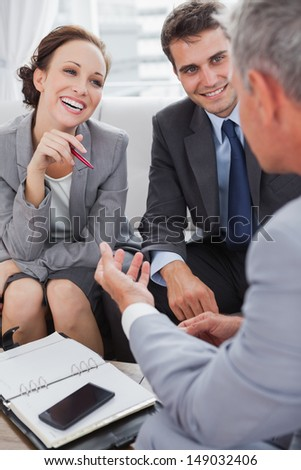 Business people arranging an appointment in cosy meeting room