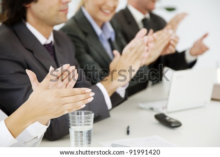 business people at a board meeting, clapping - stock photo