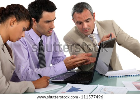 Business people at a laptop - stock photo